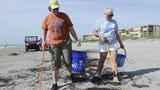 Volunteers clean the beach behind the Hilton Oceanfront in Cocoa Beach on the second stop of the Keep Brevard Beautiful/FLORIDA TODAY summer series.