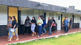 Education Superintendent Jon Fernandez and education board members lead Monday morning's walkthrough of Chief Brodie Memorial Elementary School which could be converted into a middle school.