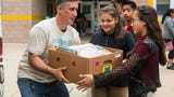 With a mission to see every child with 100 books at home, Larry Abrams of Books Smiles visits schools in South Jersey to donate books for students.