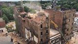 Demolition of the partially collapsed 19 Academy street continues.