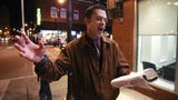 Downtown Springfield street preacher Aaron Brummitt uses a battery-powered loudspeaker to preach from a street corner.