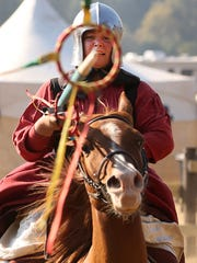 Fiona Thornton competes in a ring spearing competition during the Shrewsbury Renaissance Faire in 2014.