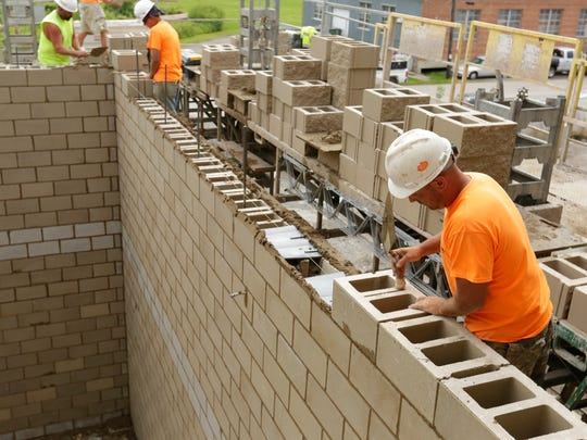 Brandon Clausen of Pahlow Masonry levels out a block that is in a stairwell of the Oshkosh Arena.  Construction crews from Bayland Buildings were setting the bleacher area and Pahlow Masonry continues to work on the masonry work at the Oshkosh Arena Friday, August 18, 2017.  The Oshkosh Arena is expected to be completed by November of 2017 and it will be the home of the Milwaukee Bucks G-League team the Wisconsin Herd.Joe Sienkiewicz / USA TODAY NETWORK-Wisconsin