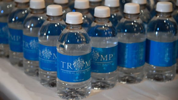 Bottled water with the Trump label sits on a table