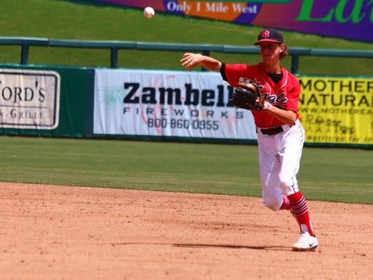 NFC second baseman Tyler Martin fields a ground ball