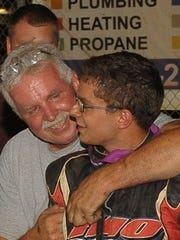 Fred Rahmer, left, hugs his son Freddie, after Freddie