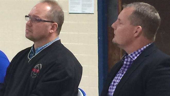 Shawn Ange, right, annd his brother, Cliff, listen to a presenter as Ange is inducted into the Athens Wrestling Hall of Fame on Thursday.