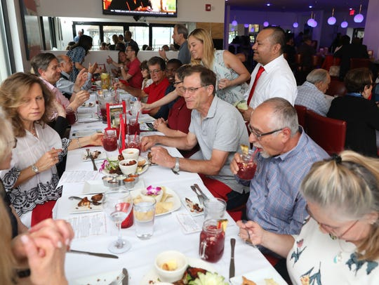 "Guests enjoy themselves during a ""Dinner with Jeanne"" event at Don Coqui On The Hudson in Haverstraw, June 27, 2018."