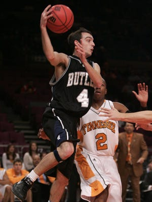 Butler Bulldongs' A.J. Graves, left, passes the ball off against Tennessee Volunteers' JaJuan Smith during the second half during the semifinals of the NIT basketball competition Wednesday, Nov. 22, 2006 at Madison Square Garden in New York. Butler won 56-44. (AP Photo/Julie Jacobson)