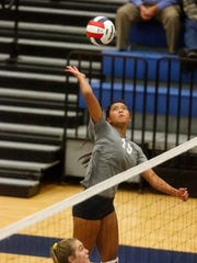 Blackman's Chianne Chanrhara hits the ball over the