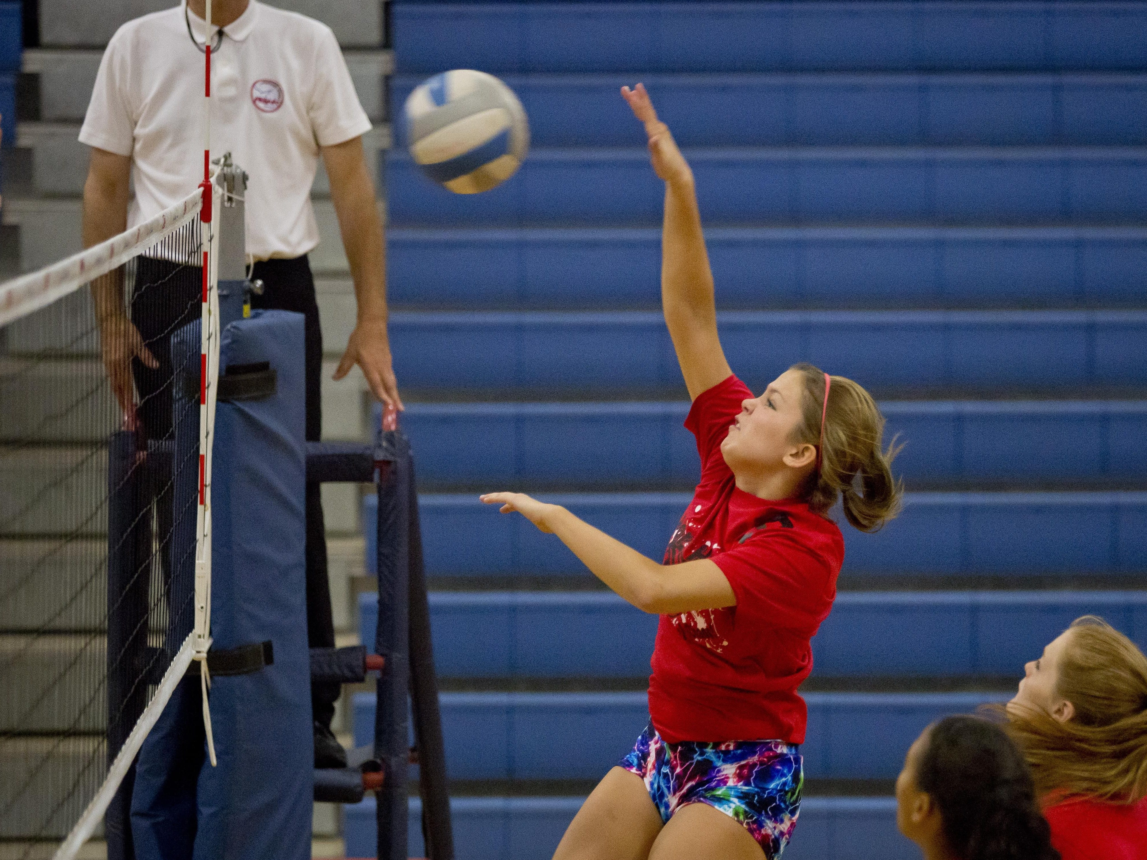 Port Huron's Brittany Goodwin spikes the ball during the Pioneer Volleyball Invitational Saturday, September 12, 2015 at Cros-Lex High School.