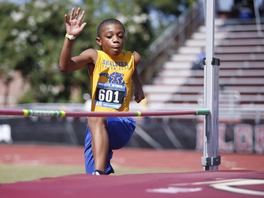 Josiah Dunlap competes in the high jump during Ernie Sims track invitational Saturday at FSU's Mike Long Track, a part of the local football star's 8th annual charity weekend.