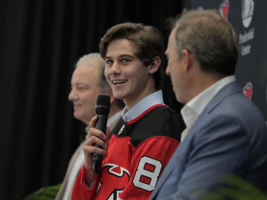 Jack Hughes, who's been on the move since the draft, fields questions at his introductory news conference Tuesday in Newark, N.J.
