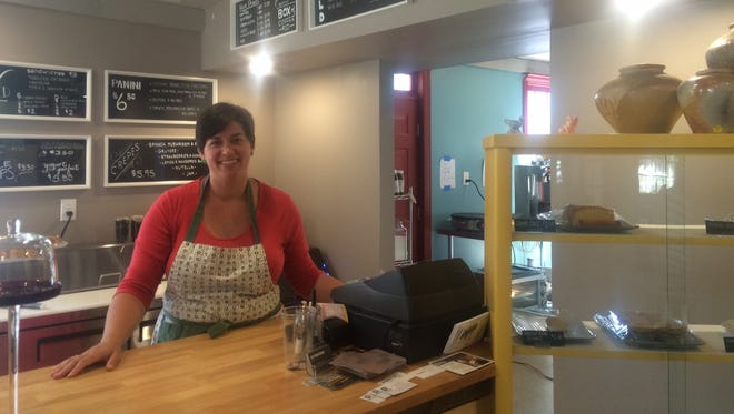 Katherine Swann is pouring the ice coffee at The Station in Merchantville. Swann owns The Station with her husband, Ato Swann, and Nicole and Mat Eiland.