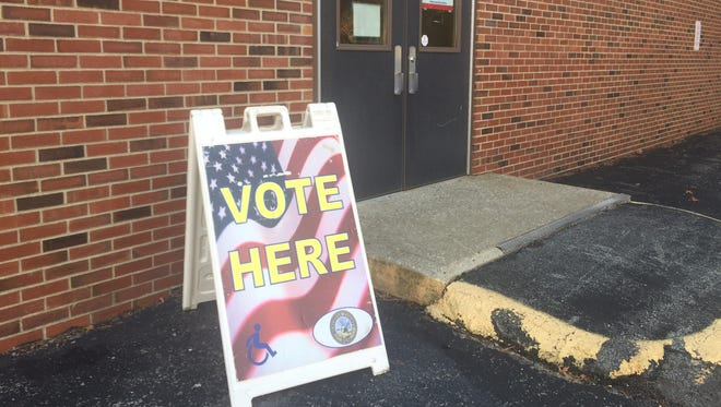 Polling signs outside Kreiger Elementary School Gymnasium Tuesday morning.