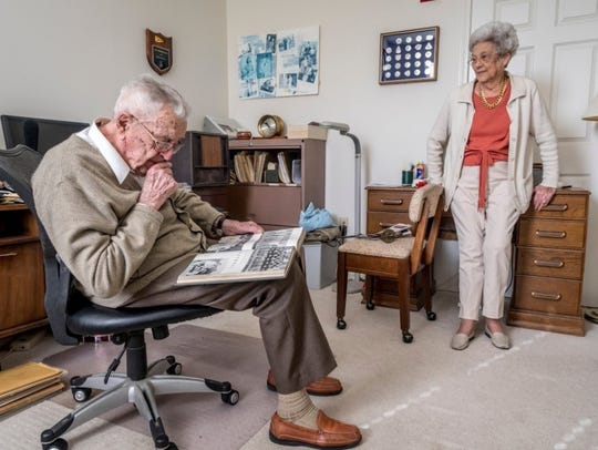 With wife Bobbe, Dyke looks through memorabilia from