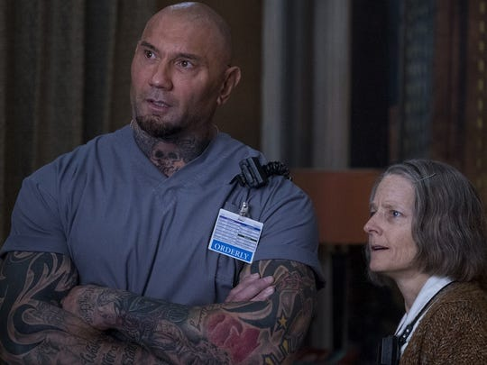 "Dave Bautista, left. and an elderly Jodie Foster work at ""Hotel Artemis."""