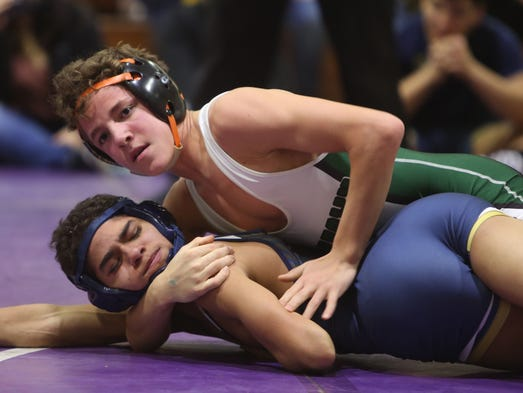 From top, Yorktown's Chris Perry on his way to defeating