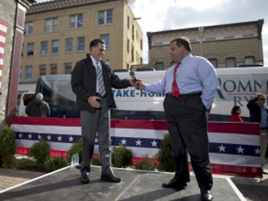 Gov. Chris Christie campaigns with Mitt Romney in Ohio in 2012. (Associated Press photo)