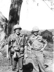 Douglas MacArthur McCrary, left, with Army buddy.