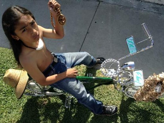 Big wheels for a big heart: 10-year-old customizes his lowrider bicycle