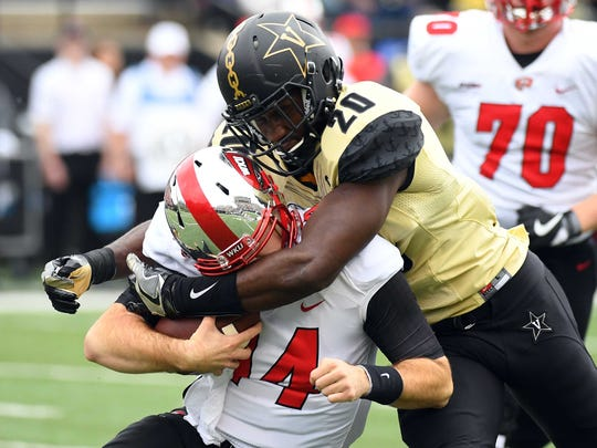 Vanderbilt linebacker Oren Burks sacks Western Kentucky QB Mike White at Vanderbilt Stadium on Nov 4, 2017.