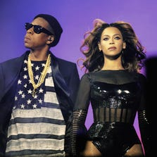 IMAGE DISTRIBUTED FOR PARKWOOD ENTERTAINMENT - Beyonce and JAY Z perform during the Beyonce and Jay Z - On the Run tour at Stade De France on Friday, Sept. 12, 2014, in Paris, France. (Photo by Mason Poole/Invision for Parkwood Entertainment/AP Images) ORG XMIT: INVL