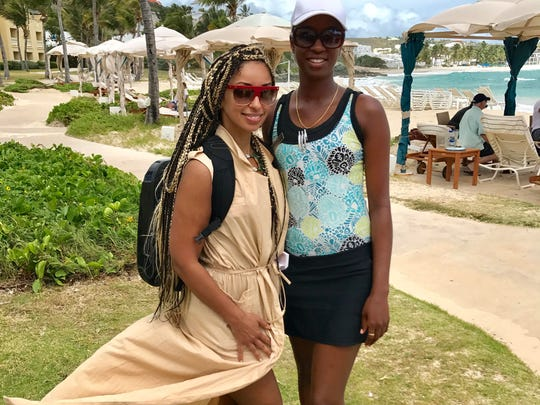 Mya, left, a singer and actress, with Chantal John at the Westin Dawn Beach Resort and Spa, where John worked, last March.