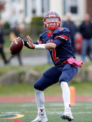 Eastchester quarterback John  Archidiacono (2) fires a pass during a varsity football game against John Jay Cross River at Eastchester High School on Saturday, Oct. 24, 2015.
