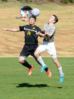 Peabody's Ben Allen and Jackson Christian's Parker Finton go up for a header on Friday in a semifinal of the Eagle Classic.