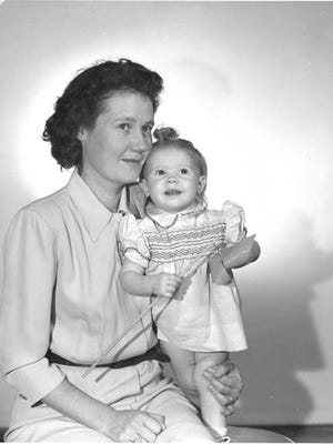 A young woman and her daughter were identified as Lola and Molly Ray Harris. The Harris family owned a sawmill in Ruidoso Downs.