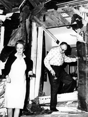 Rabbi Perry Nussbaum and his wife, Arene, leave their home after it was bombed in 1967 by Ku Klux Klan members. In the wake of such violence, a group of Methodist volunteers stepped up their efforts to heal the community -- an effort that led to the establishment of Operation Shoestring.  _