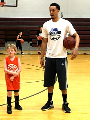 Former Station Camp and Vanderbilt standout John Jenkins, talks with one of his basketball campers, Alex Froboese, on Wednesday.