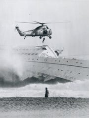 A helicopter rescues a crew member off the La Jenelle, shown sinking off the Oxnard coastline in 1970.