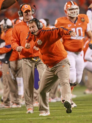 Clemson coach Dabo Swinney celebrates after a Dwayne Allen touchdown in the 2011 ACC Championship game against Virginia Tech at Bank of America Stadium in Charlotte, N.C.