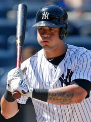 New York Yankees catcher  Gary Sanchez puffs out his