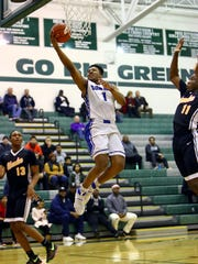 Summit guard Xavier Johnson drives and scores in the game between the Shroder Jaguars and the Summit Silver Knights in the Boys Division II Sectional Tournament at Mason High School February 24, 2018.