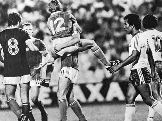 FILE - In this June 15, 1982 file photo, Hungarian Laszlo Fazekas, centre, jumps on Gabor Poloskei, after scoring the third goal for his country, during the World Cup soccer match between Hungary and El Salvador, in Elche, Spain. Hungary's Tibor Nyilasi, stands at left. On this day: Hungary defeated El Salvador a record 10-1. (AP Photo/File)