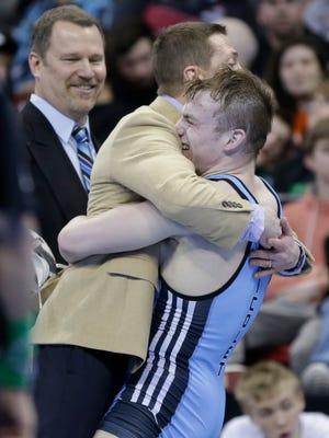 Nicolet's Parker Keckeisen celebrates after beating Holmen's Kalyn Jahn in the Division 1 170-pound match.