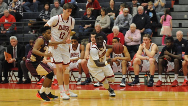 Shippensburg's Abe Massaley (1) dribbles the ball against Bloomsburg on Saturday in the first round of the PSAC Tournament. Massaley hit a game-winning layup to lift the Raiders to an 80-78 win.