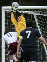 Arcadia keeper Kain Turner makes a save during the