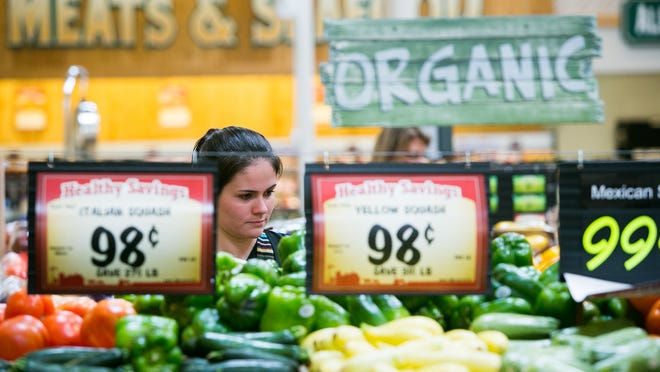 Dana Eichele shops the produce section at a Sprouts grocery store in Paradise Valley in 2013.