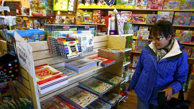 A customer shops for gifts at Kidtopia.