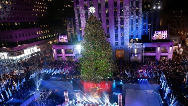 The Rockefeller Center Christmas tree is lit during a ceremony,on Dec. 4, 2013, in New York.