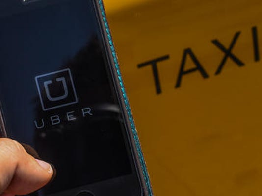 635665048034050234-uber-taxi