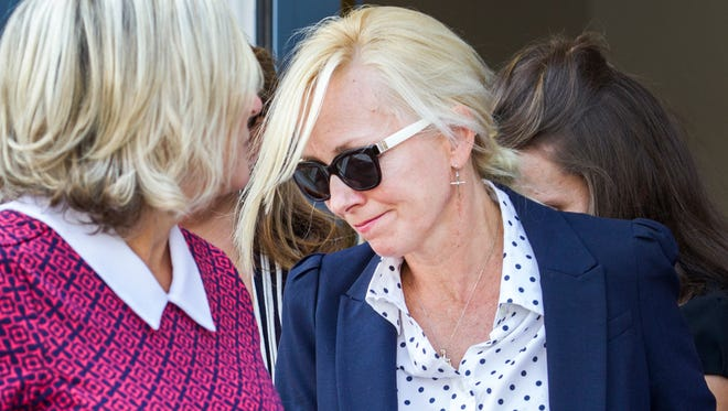 Former Baltimore Ravens cheerleader Molly Shattuck is led out of the Sussex County Courthouse in Georgetown, Del. on Friday morning.