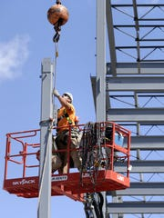 Joe Mchugh, an ironworker with The Boldt Co., works on the Gateway office building in downtown Neenah.