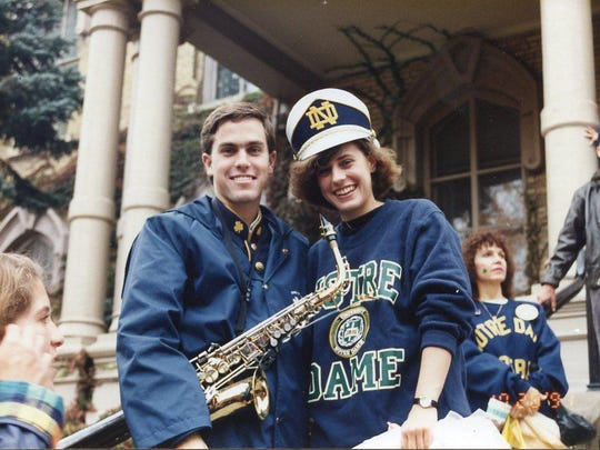 Bill Whitltach, Jr., smiles after putting his cap on his sister Lynn's head prior to the Notre Dame home game against USC during his sophomore year at Notre Dame University.