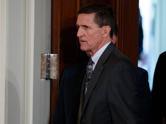 Michael Flynn arrives for a news conference in the East Room of the White House in Washington on Feb. 13, 2017. Flynn resigned following reports he misled Vice President Mike Pence and other officials about his contacts with Russia.