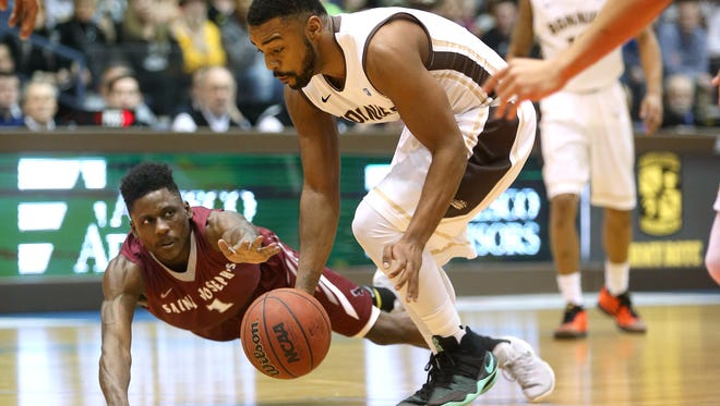 St. Bonaventure's Marcus Posley steals the ball from St. Joseph's Shavar Newkirk to go on and score. Posley led all scorers with 47 points as the Bonnies won 98-90.